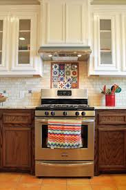 spanish style kitchen design with saltillo tile floors and