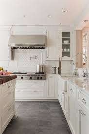 kitchen floor ideas with white cabinets white cabinets paired with supreme white quartzite