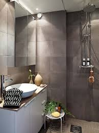 brick wall design in small bathroom with mirror doors for wall
