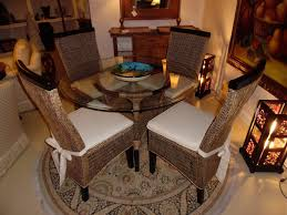 rattan dining chairs in both indoor and outdoor rooms glass top jupiter rattan dining set of round table 4 chairs by