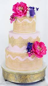 pink and gold lace wedding cake with flowers deer pearl flowers