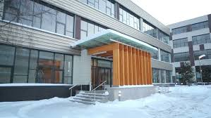 entrance to business center and courtyard at winter snowy day stock
