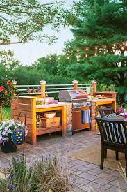 best 25 backyard kitchen ideas on pinterest outdoor kitchens get the look of an expensive outdoor kitchen for less surround a gas grill with