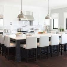 white kitchen islands with seating white cabinets hardware stainless appliances wood floors