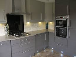 grey painted kitchen cabinets with beautiful lighting 2588