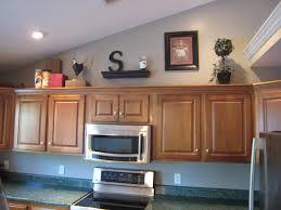 above kitchen cabinet decor ideas ideas for decorating above kitchen cabinets decorating ideas for