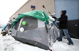 two black friday shoppers are already ced outside a best buy