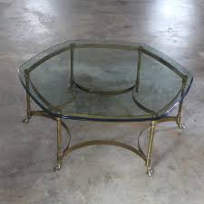 hollywood regency brass and glass hexagon coffee table with hoof feet