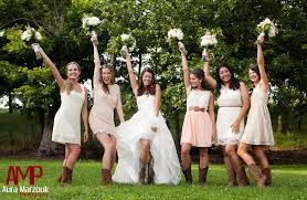 bridesmaid dresses with cowboy boots bridesmaids pose in their lovely ivory lace bridesmaid dresses