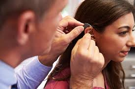 hairstyle that covers hearing aid wearer royalty free hearing aid pictures images and stock photos istock