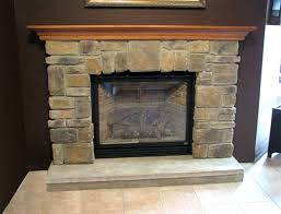 stacked stone fireplace over brick