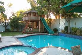 backyard designs with pool swimming pool with hardscape and