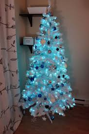 white christmas tree with blue decorations home decorations