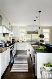 black kitchen countertops with white cabinets 25 black countertops to inspire your kitchen renovation