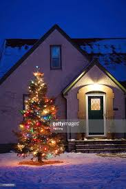 decorated outdoor tree in front of house vt stock photo