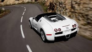 white bugatti veyron supersport white bugatti veyron super sport on a winding road near the rock