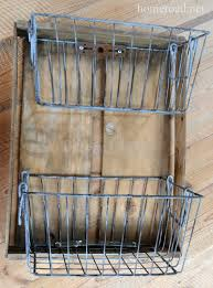 turn rustic metal baskets into shelves for the bathroom home