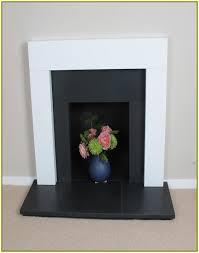honed black granite fireplace surround