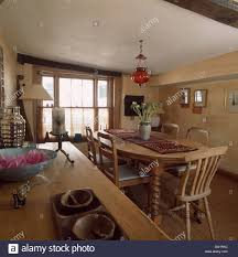 cottage dining room pine table and chairs in simple economy style cottage dining room