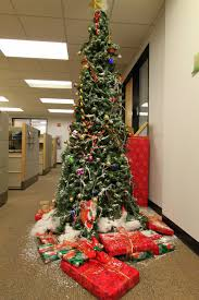 the office holiday pole decorating contest mid century modern