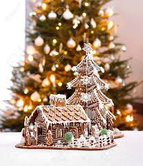gingerbread cottage house and christmas tree home interior