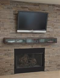 narrow floating media cabinet with frosted glass door over wall