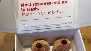 Resume For Courier Driver Man Hands In Cv To Employers Disguised As Doughnut Delivery