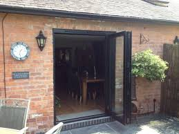 Bifold Patio Doors A Small Set Of Bi Folding Doors Opened And Stacked To Allow Access