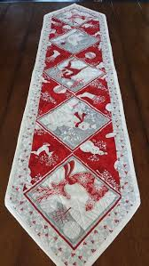 white and silver table runners by serenabeanquilts