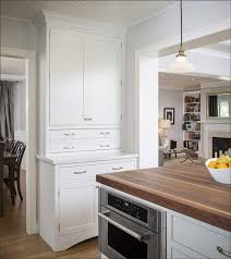 kitchen with white cabinets and wood countertops 10 benefits of wood countertops