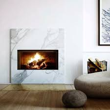 marble fireplace with copper detailing living spaces