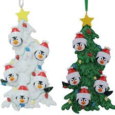 resin penguin family of 5 ornaments with white tree as
