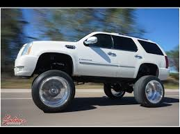 cadillac escalade lifted the tallest cadillac suv you will see 26x16 wheels on a 12 inch