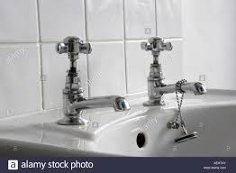 Silver Bathroom Sink White Bathroom Sink With Silver Taps And Plug Stock Photo Royalty