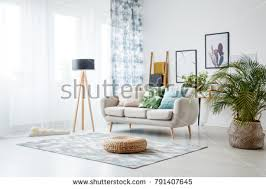 floor in black l standing by sofa row stock photo 791407645