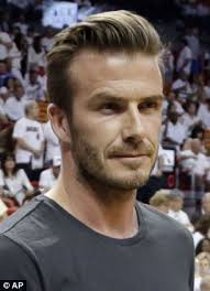 side view of pulled back hair in a bun black men haircut styles 2013 hairstyle for women man