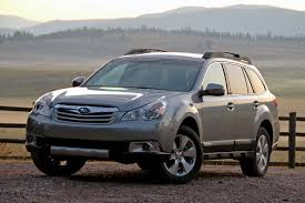 tan subaru outback vwvortex com battle of the similarly named cuvs 2010 outlander