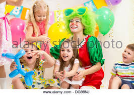clown for birthday party nj jolly kids with clown celebrating birthday party stock photo