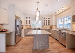 Just Cabinets And More by Gray Island With White Cabinets And Wood Floors White Walls