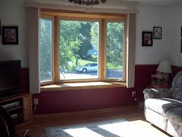 window treatments for bay windows plantation shutters to each bay window treatment ideas pictures of bay windows office
