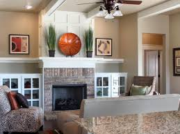 built in white cabinets flank a brick fireplace with contemporary