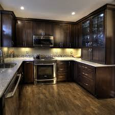 dark cabinets stainless appliances kitchen traditional with mosaic