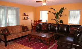 Family Room Design With Brown Leather Sofa Hardwood Carving Rectangular Coffee Table Hacienda Style Furniture