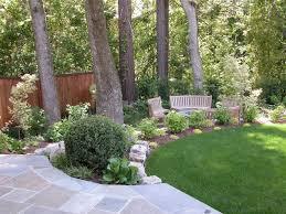 flower garden idea for around tree bluestone walk leads to