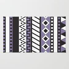 purple tribal print rug by dani society6