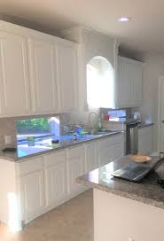 how to paint stained kitchen cabinets white 5 tips painting kitchen cabinets white and the