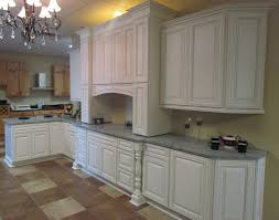 granite countertop white kitchen cabinets with glass doors
