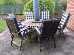 hartman real teak patio set with 6 chairs and cushions in melton