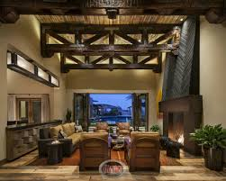 lake travis outdoor evening by zbranek holt custom homes austin rustic living room with elevated exposed wood beamed ceiling by red rock contractors 31 custom jaw dropping rustic interior design ideas photos
