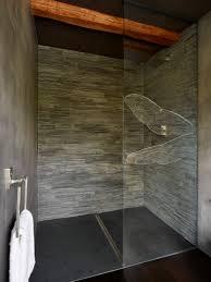 split face grey slate shower wall with honed black slate shower
